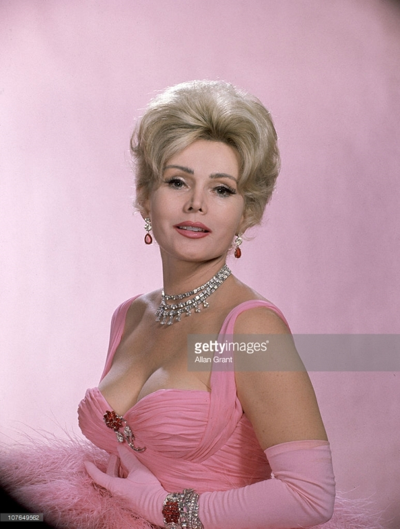 Subject: Zsa Zsa Gabor wearing vulture feathers and $600,000 worth of jewelry for Dune's Club appearance. Las Vegas, Nevada 1961 Photographer- Allan Grant Time Inc Owned Merlin-1153326