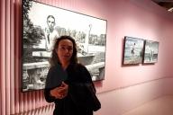Photographer Wendelien Daan in front of some of her images