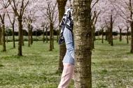 "Headless girl walking at the park. Photography Wendelien Daan. Silk scarf ""stallion""; Mimi Berlin, clohes models own."